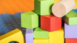 coloured children's blocks on a play mat