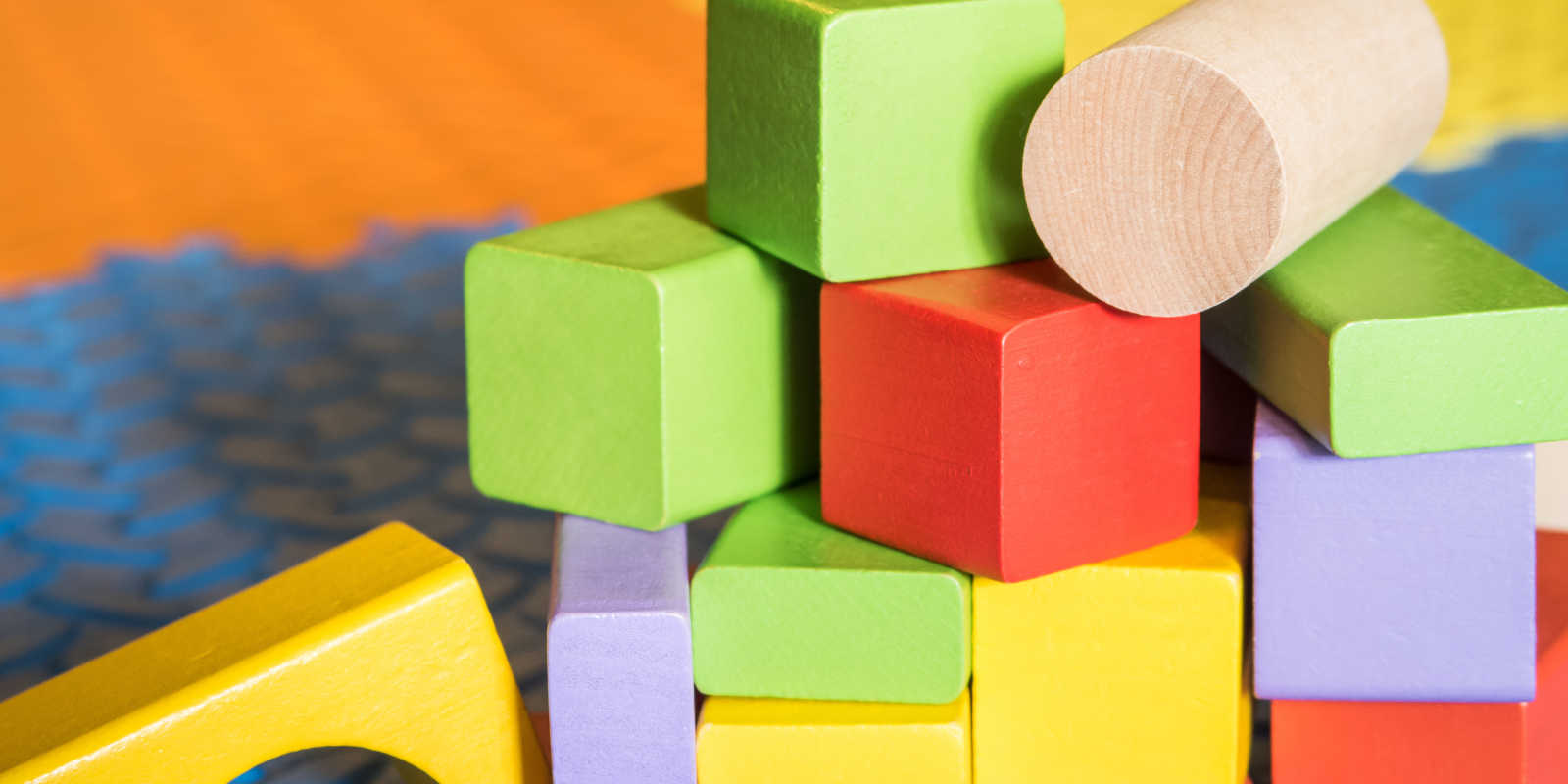 coloured children's blocks on a play mat