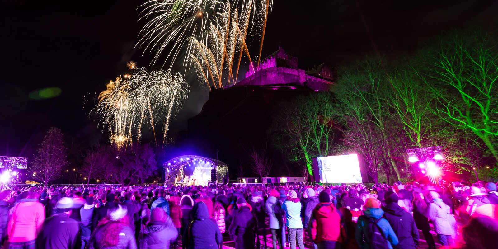 Revellers watching the fireworks above Edinburgh Castle on Hogmanay