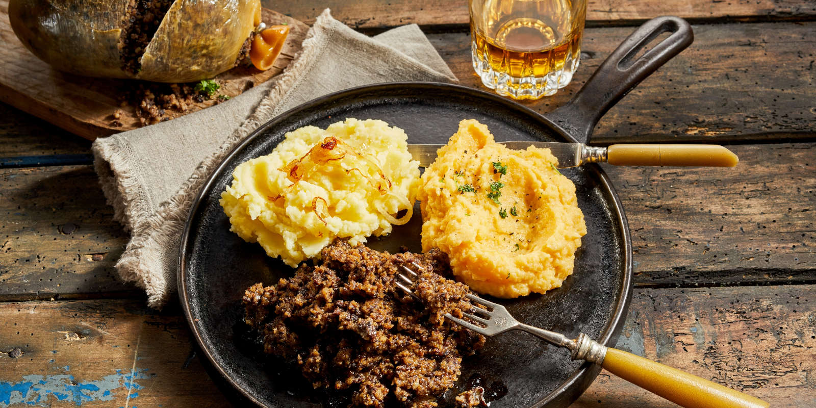 A traditional Burns Supper of haggis, neeps and tatties with a glass of whisky