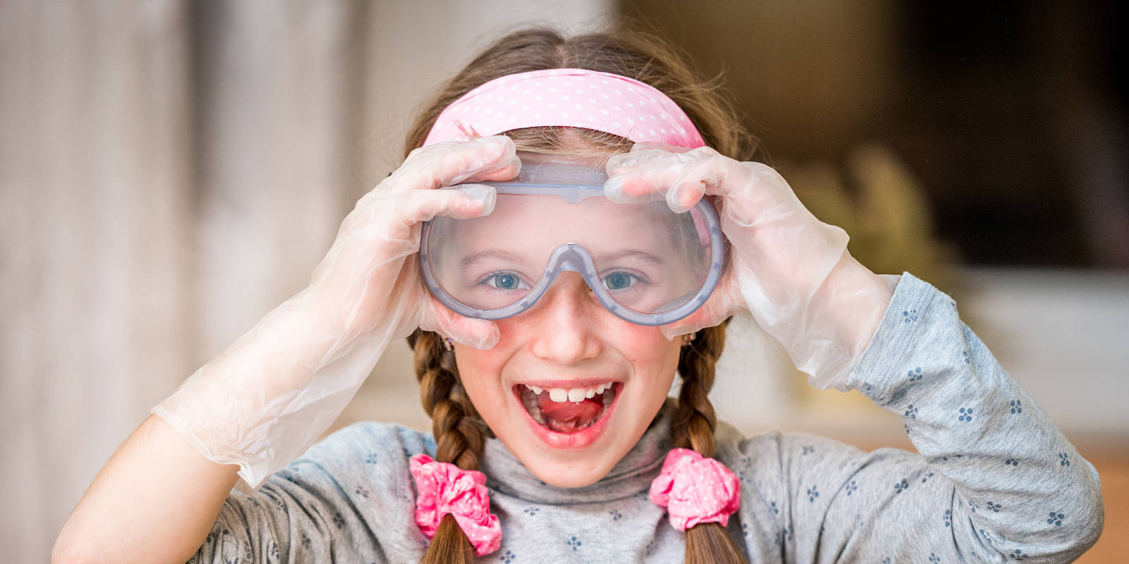 Girl wearing scientific goggles and smiling