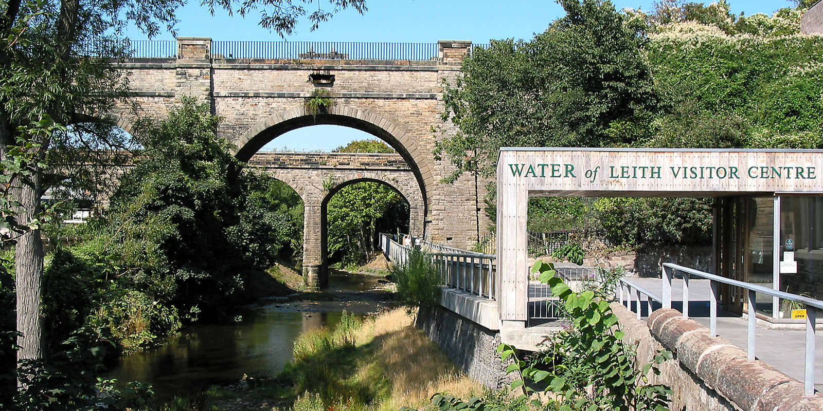 Water of Leith Visitpr Centre with river and arched bridge