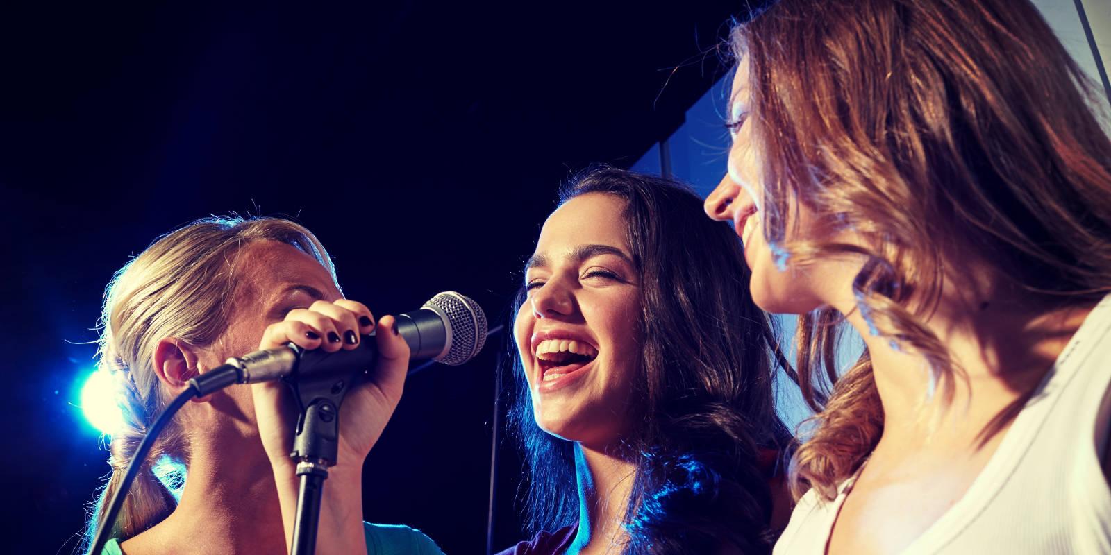 Three girls singing karaoke