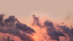 Smoke from chimneys fills the sky