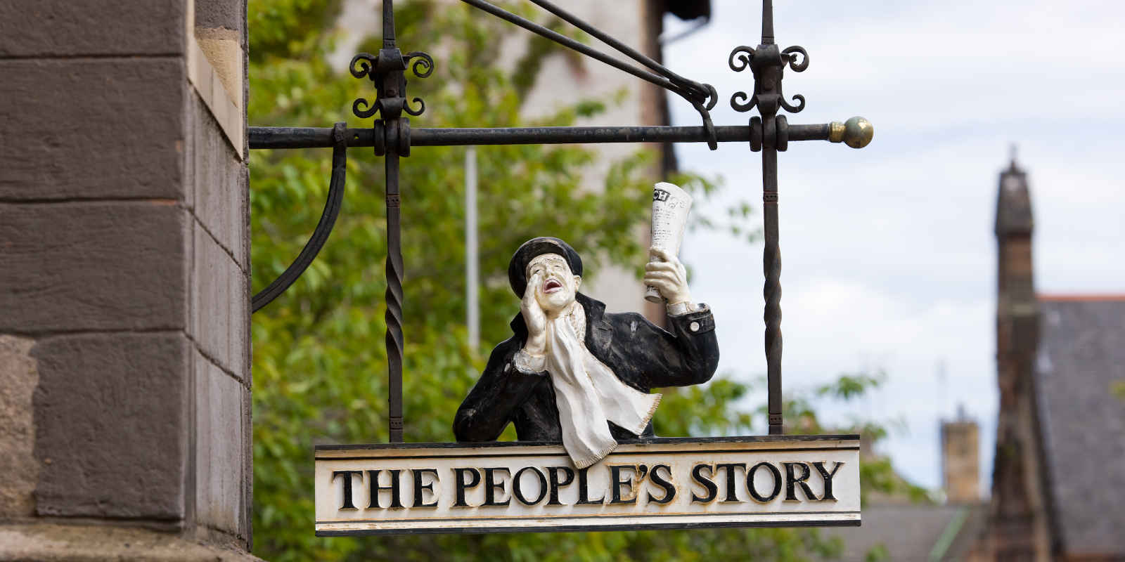 Metal sign outside The People's Story Museum in Edinburgh