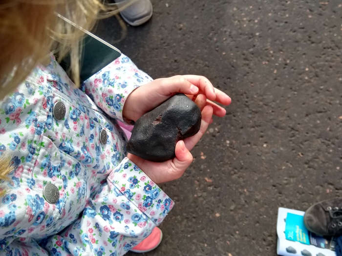 Girl holding a meteorite