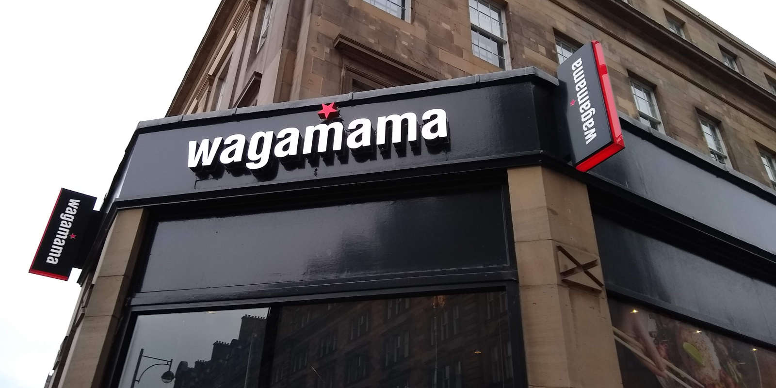 Sign above door at Wagamama restaurant