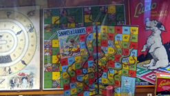 Old board games including Snakes and Ladders and Ludo