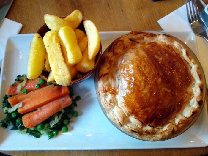 Chicken pie with chips and vegetables