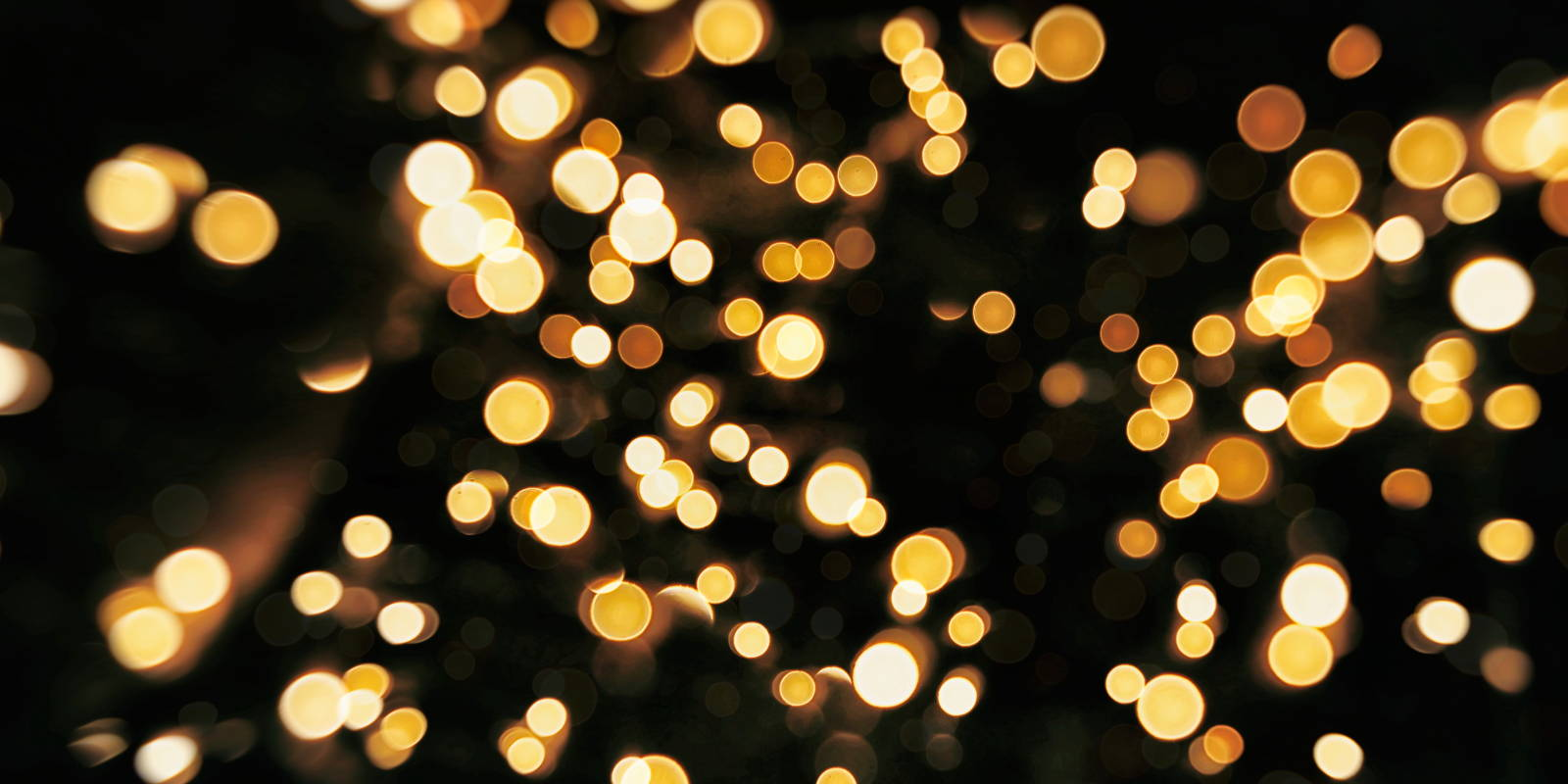 Golden fairy lights with black background